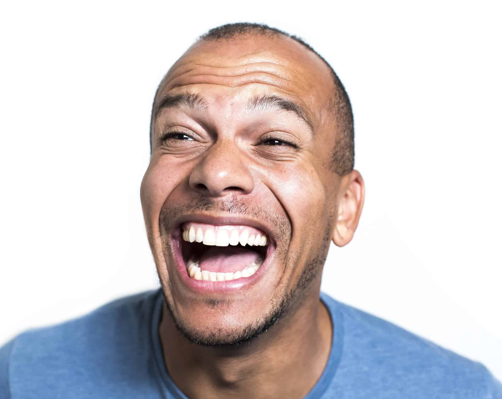 Portrait of a mixed race man laughing hysterically - BKA ...