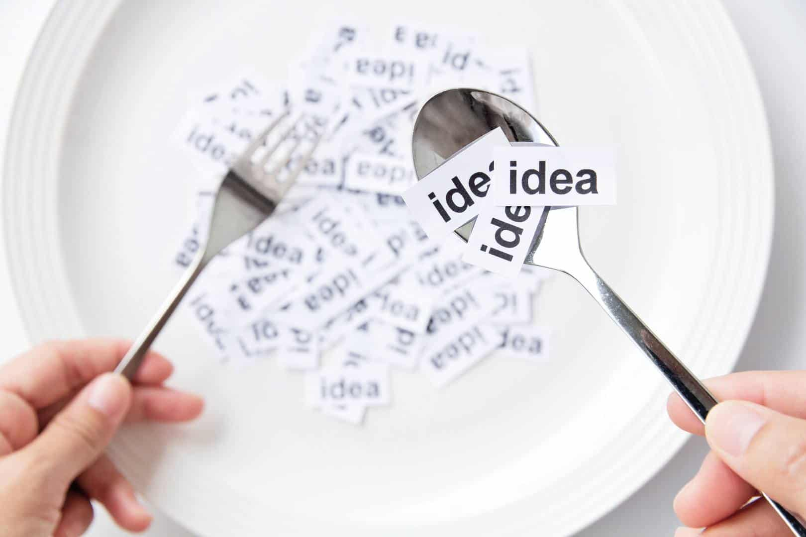 "Bowl filled with slips of paper labeled ""idea"""
