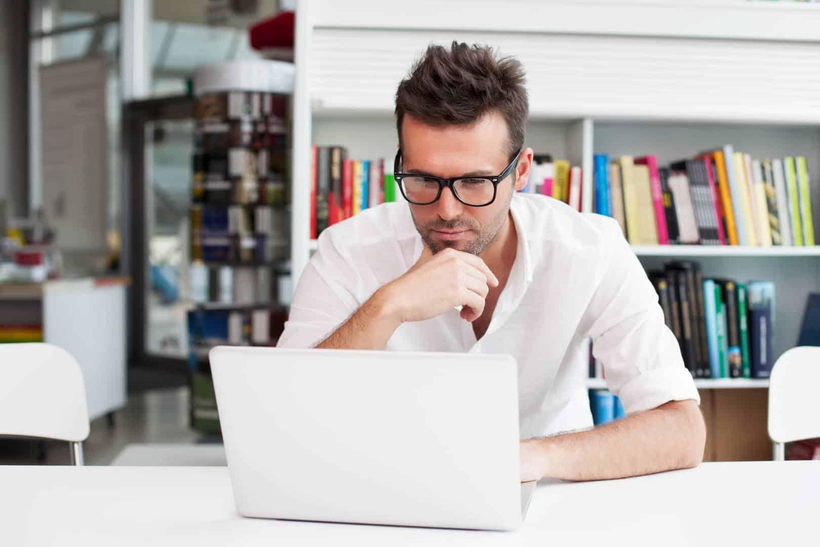 working hard, editing, man working on laptop